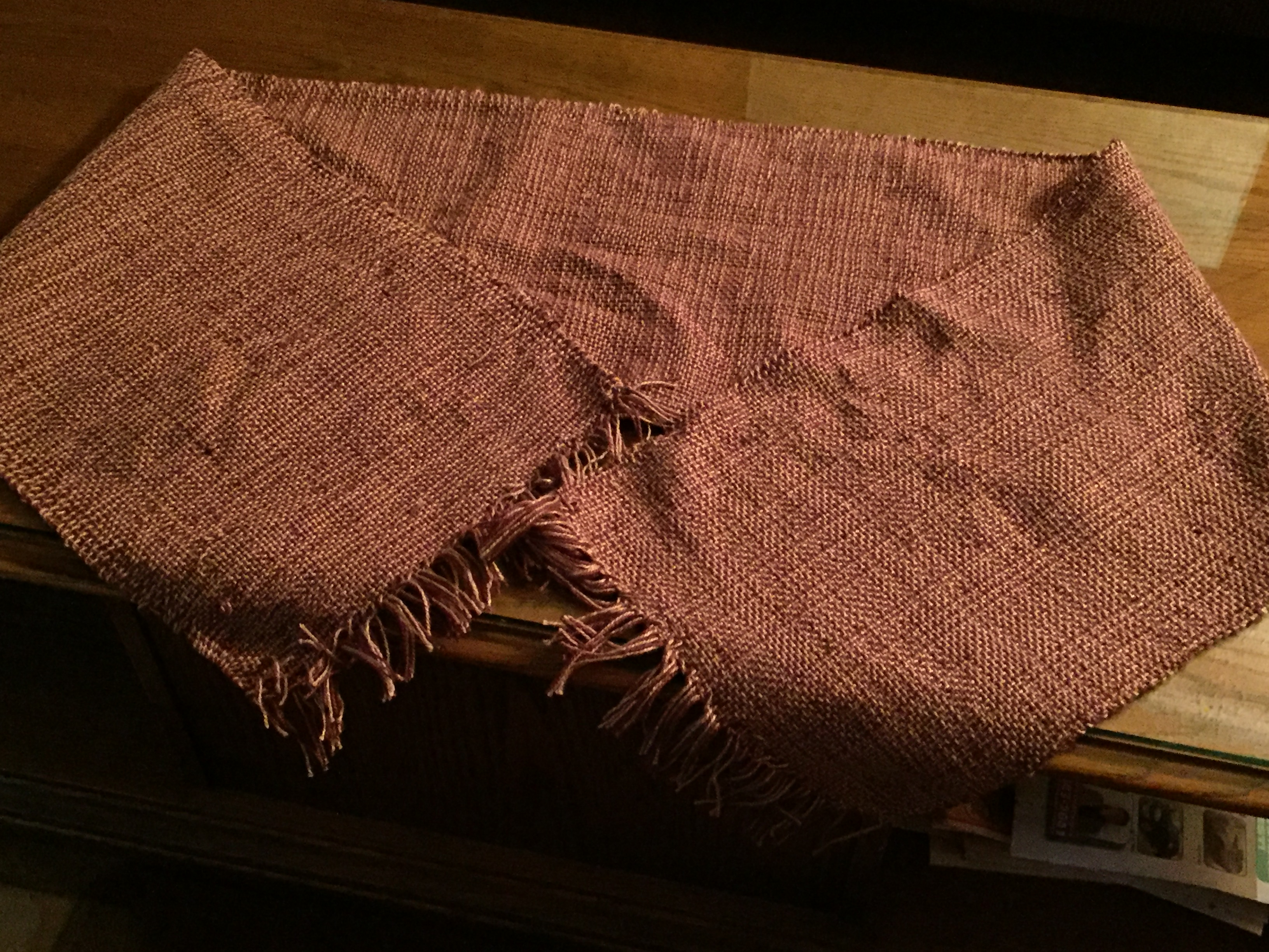 Weaving a rigid heddle table runner requires you to be flexible about making mistakes, as was the weaver of this handwoven runner.