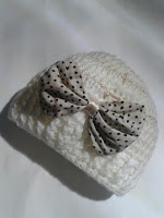 This crochet hat has the perfect bow embellishment.