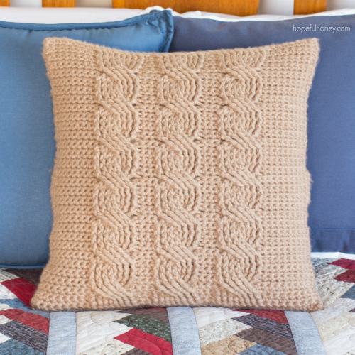 This crochet pillow cover with its crochet cables is incredible.