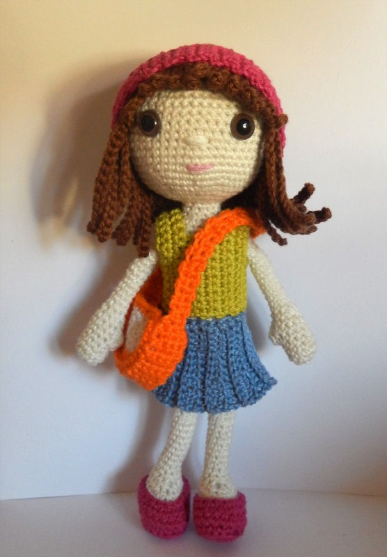 This free amigurumi doll crochet pattern is adorable.