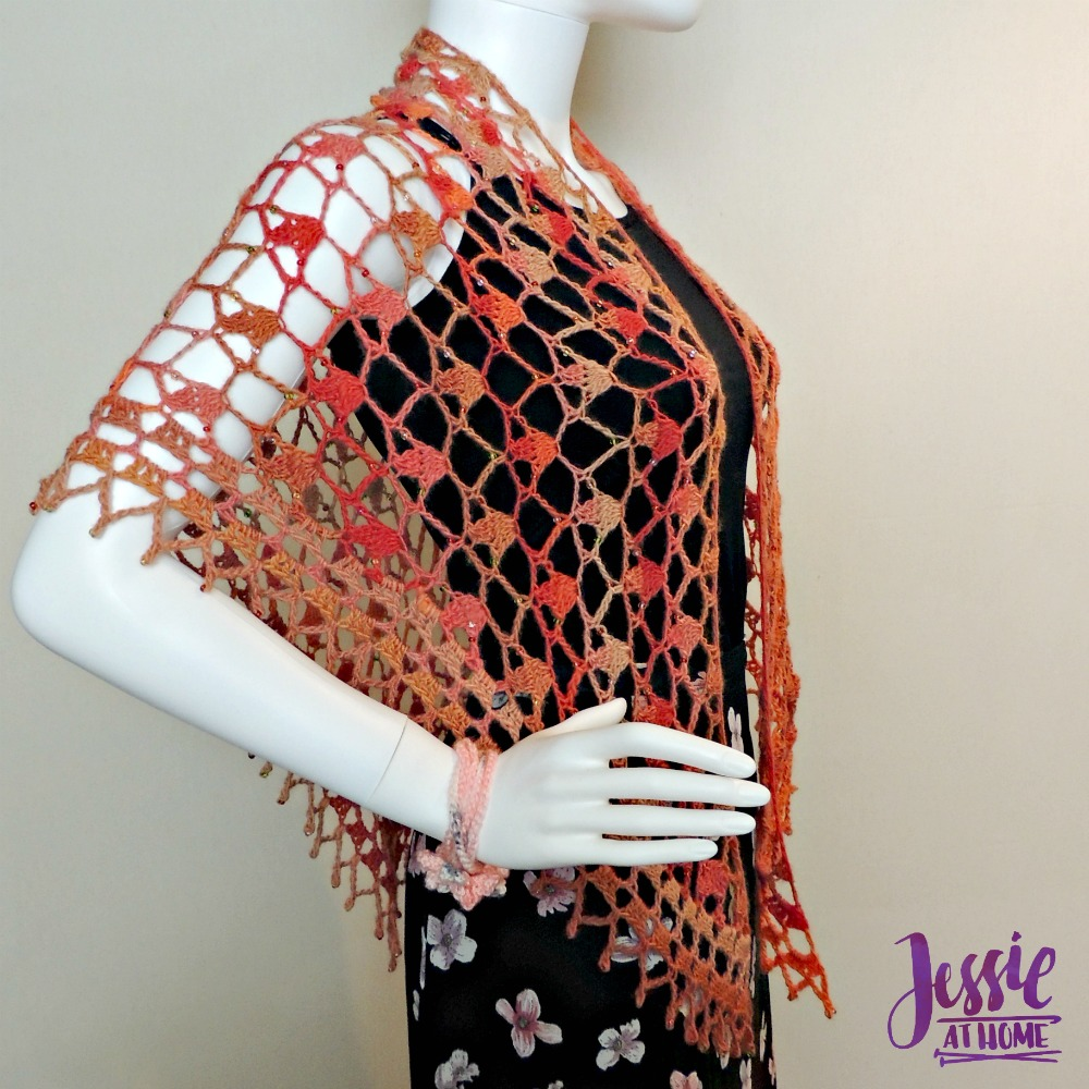 This lovely lace crochet shawl has a bit of sparkle.