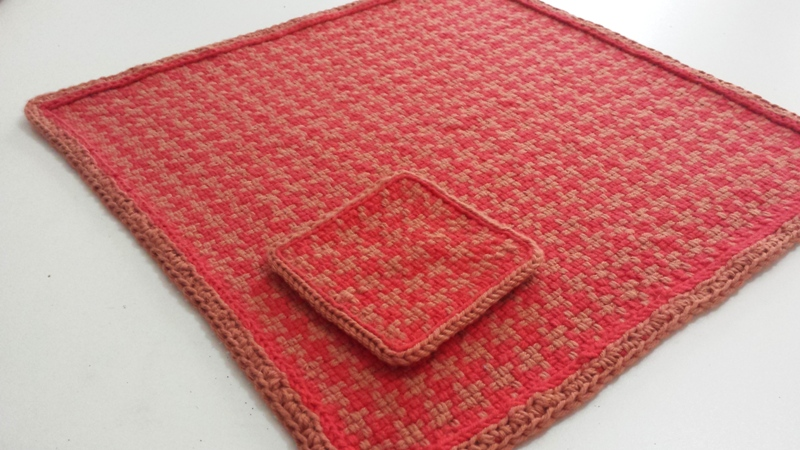 Small looms like a frame loom or pin loom can be used to make fun, attractive projects, like this woven placemat and coaster.