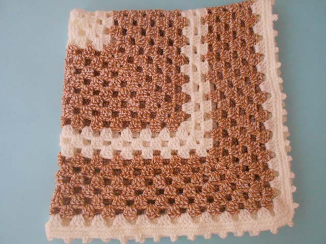 This granny square crochet baby blanket is easy and makes a great gift.