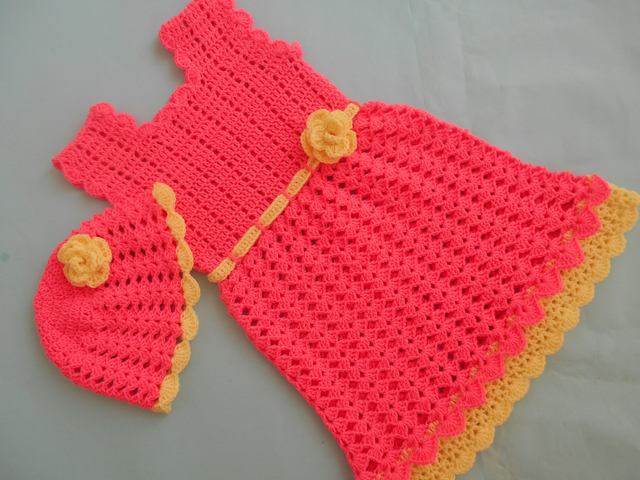This baby crochet dress is perfect for a summer party.