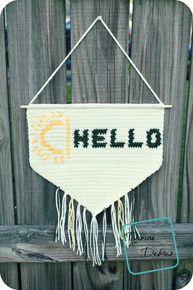 This tapestry crochet banner makes a fun house warming gift.