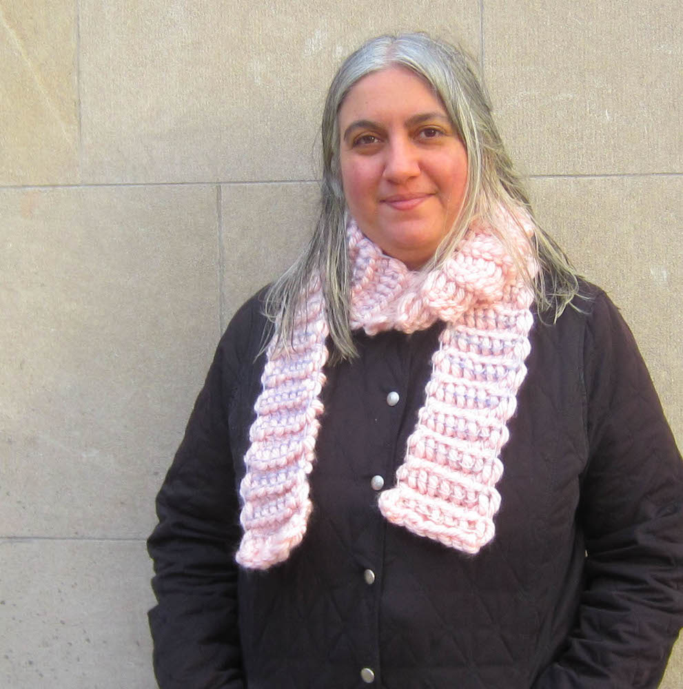 Make this chunky crochet scarf. It's a free crochet pattern.