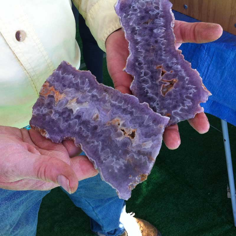 "10+ Way Cool Cabochons from Around the World Seen in Tucson. ""Ghost quartz"" amethyst slab from Arizona is just waiting to be cut into a cab by the guy who dug it up and is shown showing it off at the Kino Gem and Mineral Show: John Heusler of Slabs to Cabs."