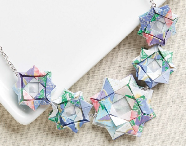 learn to make paper jewelry like this origami flower necklace