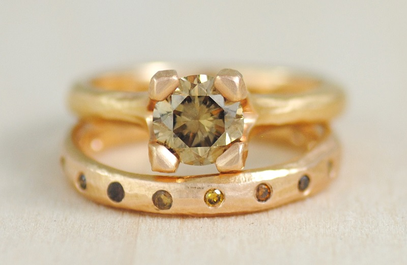 Diamond's variety of color is well demonstrated by the yellow, coffee, cognac, chocolate, and black stones in this wedding band. The 18k rose gold mounting complements the warmth of the 1.07 carat cognac center stone in the engagement ring. Design by Michael Endlich, photo by Sarah Francis, courtesy Pavé Fine Jewelry.