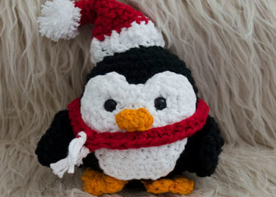 Stuffy the Christmas penguin crochet ornament pattern.