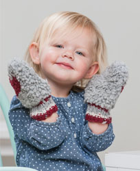 Our adorable model showing her not-so-serious side while showcasing the buff mittens.