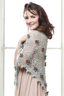 This gorgeous lace crochet shawl is embellished with crochet flowers.