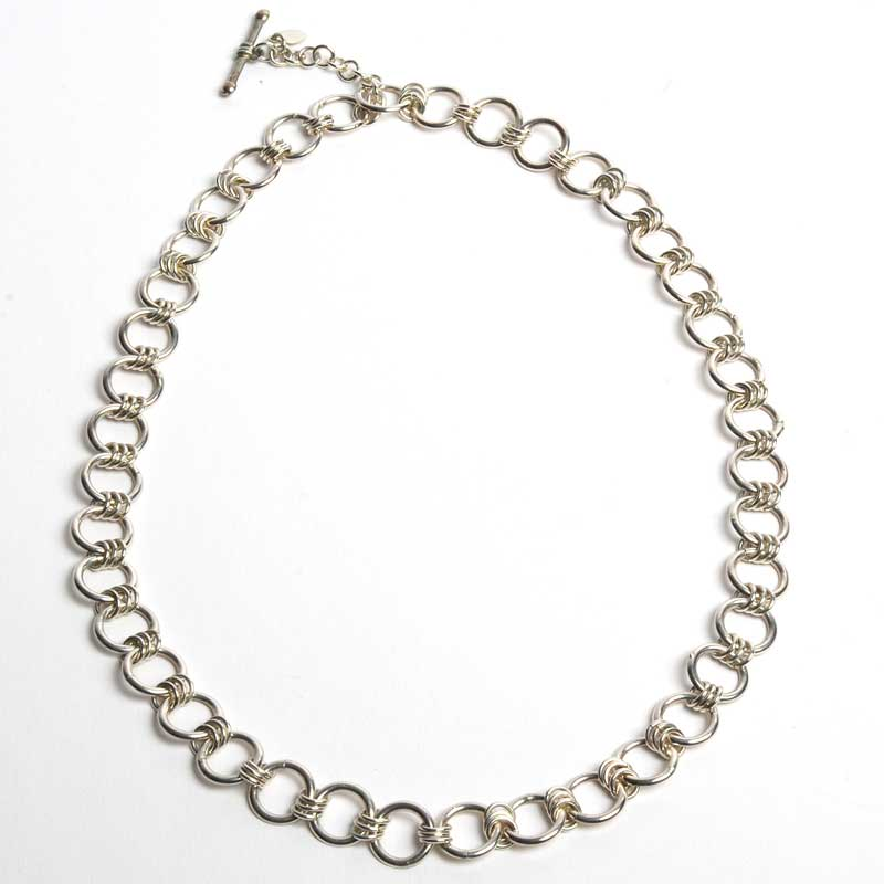 Sterling silver round and half-round wire formed into links then assembled to create this finished chain, by Locadio Medina.