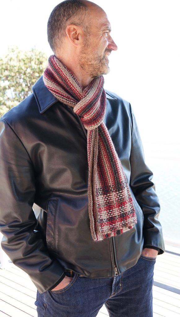 Check out this Reversible Plaid Scarf knitting pattern! It's done in garter-stitch and then lengths of yarn are woven in and out of the garter rows to create a woven look.