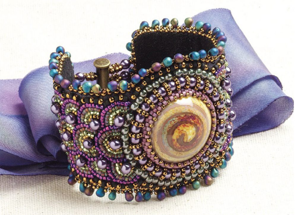 Ripple Effect Cuff by Sherry Serafini, bead embroidered design with found objects and beaded edging; bead embroidery