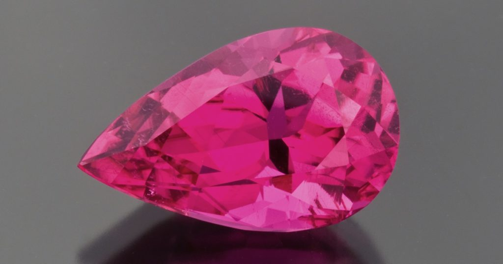 "pink gemstones: For beautiful pink gemstones, you can do no better than a fine rubellite. This 8.51 carat pear is exceptional. For children of the 1970s, this would be called ""hot pink"" and was definitely considered sexy. Photo Mia Dixon, courtesy Pala International."