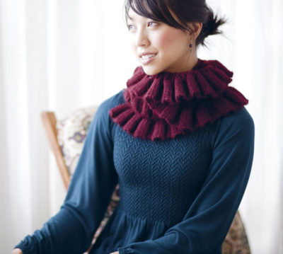 Knit the Nerina Ruched and Ruffled scarf knitting pattern found in our FREE eBook of ideas for knitting gifts.