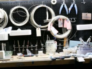 Sarah Thompson's work area filled with tools and wire!