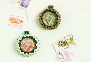 Learn how to make cabochon jewelry with beads using resin and used postage stamps in this free beading project.