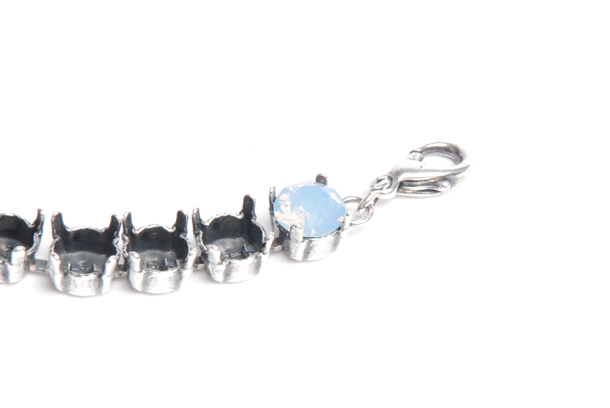crystal chaton set into the cup-chain setting. Silver oxide cup chain bracelet; air blue opal Swarovski crystal chaton