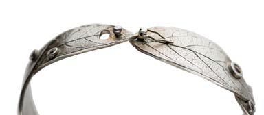 jewelry design: Silver leaf bracelet with clasp open; photo: Jim Lawson