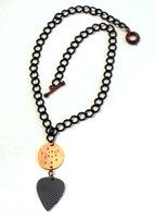 metal stamped guitar pick necklace by Sara Richardson