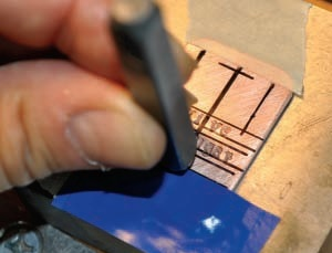 tape down metal blanks for stamping