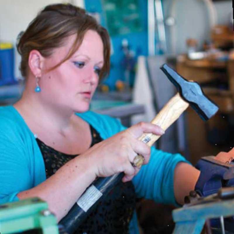 Veteran jewelry designer Tara Hutchinson at work