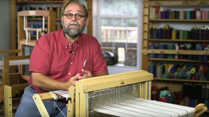 "Tom Knisely in <em><a href=""https://www.interweave.com/store/learn-to-weave-making-good-cloth-multi-shaft-loom-video-download"" target=""_blank"">Learn to Weave</a></em>"