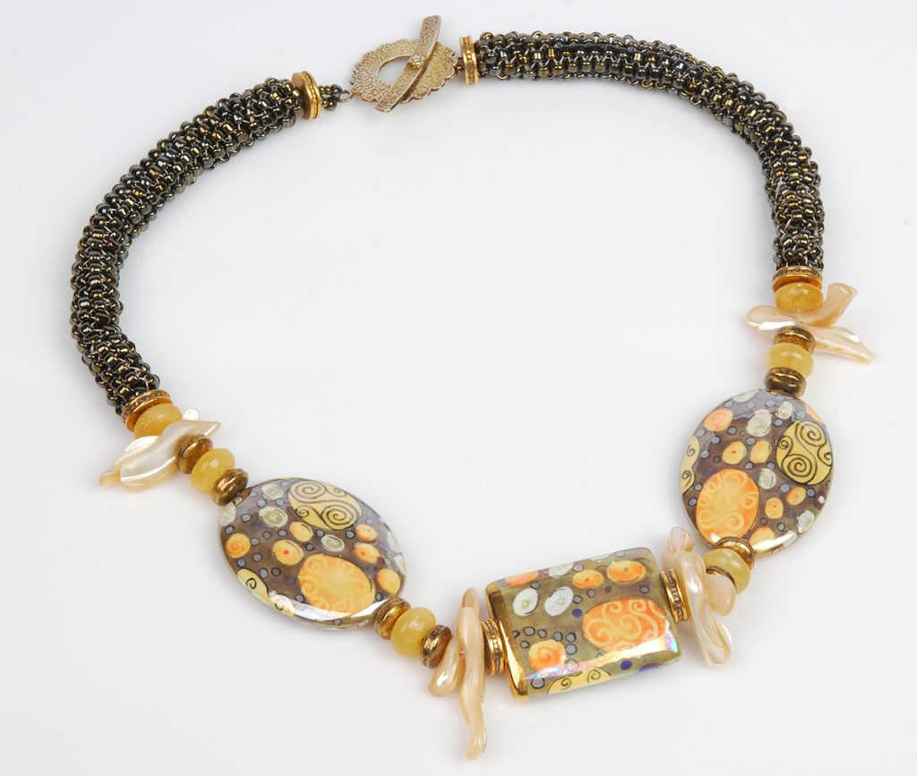 Beaded Ropes necklace by Tammy Honaman. Tubular peyote paired with handmade hand painted porcelain beads