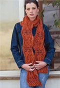 The Wavy Orange Scarf is an orange colored knitted scarf pattern found in our free Knitting Scarves for all Seasons eBook.