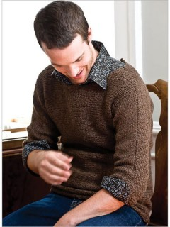 The designer slips stitches all the way up the sleeves of this pullover. Worked sideways in one piece from cuff to cuff, linen stitch adds a simple, straightforward embellishment to collar, cuffs, and yoke.