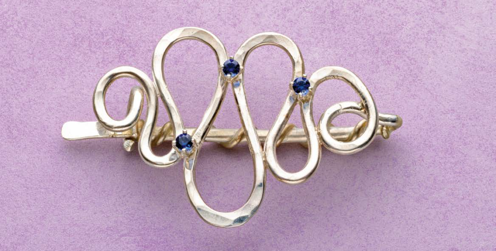 Small or large, the right stones in the right settings can make a lovely piece of jewelry extra special. Noël Yovovich's Starlight in Her Hair Argentium Sterling Silver barrette with prong-set iolites. Photo: Jim Lawson.